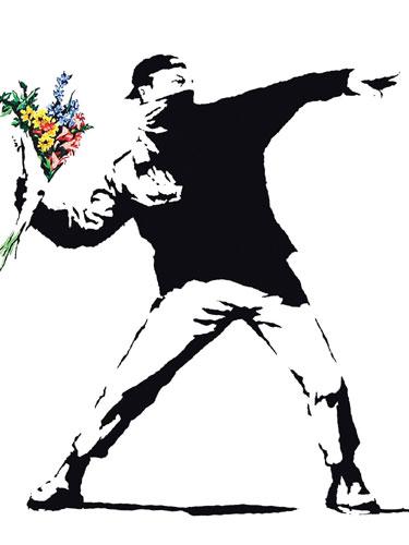 Graffiti em uma parece feita por  Banksy